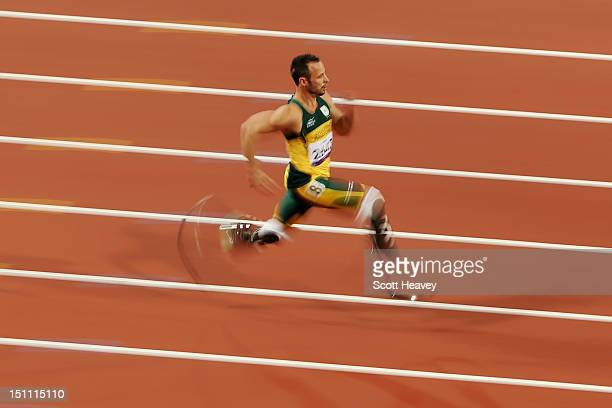 Oscar Pistorius of South Africa breaks the world record with a time of 2130 as he competes in the Men's 200m T44 heats on day 3 of the London 2012...