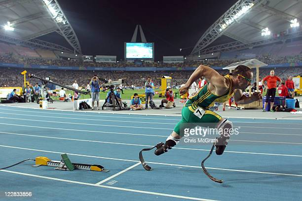 Oscar Pistorius of South Africa bursts out of the blocks in front of photographers at the start of the men's 400 metres semi finals during day three...