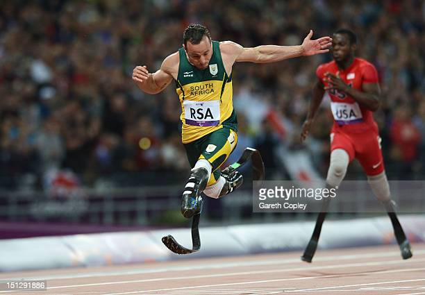 Oscar Pistorius of South Africa crosses the line to win gold for this team in the Men's 4x100m relay T42/T46 Final on day 7 of the London 2012...