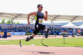 Oscar Pistorius of South Africa on his way to victory in the men's T42/43/44 200m during day one of the BT Paralympic World Cup at Sportcity on May...