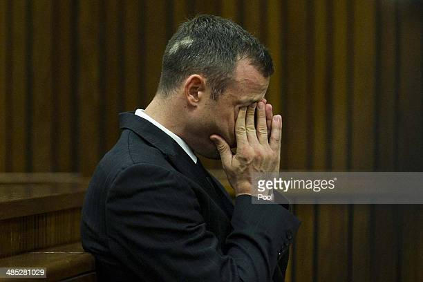 Oscar Pistorius on his cell phone while sitting in the dock in the Pretoria High Court on April 17 in Pretoria South Africa Oscar Pistorius stands...