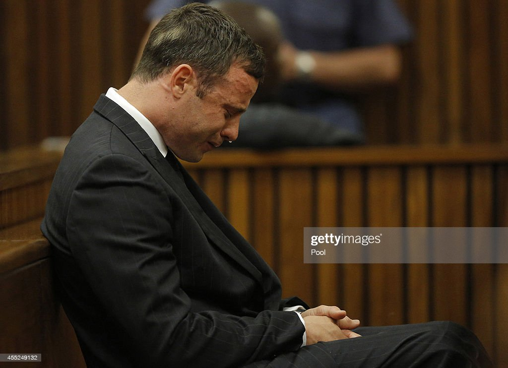 <a gi-track='captionPersonalityLinkClicked' href=/galleries/search?phrase=Oscar+Pistorius&family=editorial&specificpeople=224406 ng-click='$event.stopPropagation()'>Oscar Pistorius</a> reacts in the Pretoria High Court on September 11, 2014, in Pretoria, South Africa. South African Judge Thokosile Masipa has ruled out murder charges, but has left it to tomorrow to announce whether <a gi-track='captionPersonalityLinkClicked' href=/galleries/search?phrase=Oscar+Pistorius&family=editorial&specificpeople=224406 ng-click='$event.stopPropagation()'>Oscar Pistorius</a> is guilty of culpable homicide as the six month trial of the Olympic double-amputee sprinter comes to an end. His defence maintained that Mr Pistorius mistook Ms Reeva Steenkamp for an intruder in his home when he fired several shots into his bathroom allegedly in self-defence but killing his girlfriend.