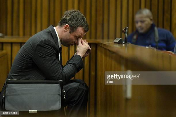 Oscar Pistorius sits in the dock during closing arguments in his murder trial in the Pretoria High Court on August 8 in Pretoria South Africa Oscar...