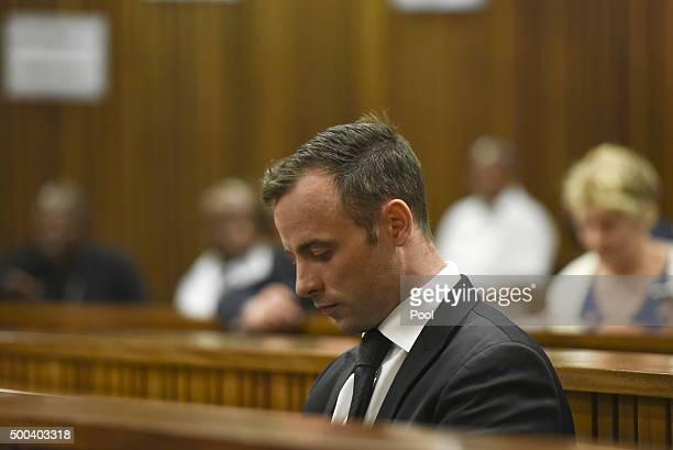 Oscar Pistorius sits inside the Pretoria High Court on December 8 in Pretoria South Africa Oscar Pistorius briefly appeared in court today for his...