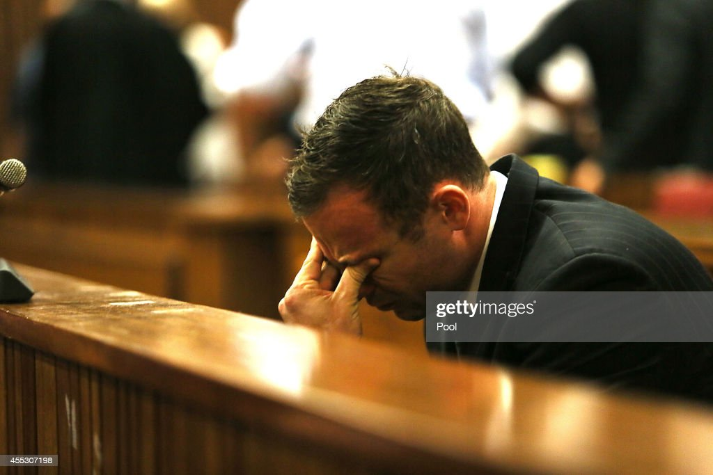 <a gi-track='captionPersonalityLinkClicked' href=/galleries/search?phrase=Oscar+Pistorius&family=editorial&specificpeople=224406 ng-click='$event.stopPropagation()'>Oscar Pistorius</a> takes his seat during his trial at the Pretoria High Court on September 12, 2014, in Pretoria, South Africa. South African Judge Thokosile Masipa has ruled out murder charges, but has left it to today to announce whether <a gi-track='captionPersonalityLinkClicked' href=/galleries/search?phrase=Oscar+Pistorius&family=editorial&specificpeople=224406 ng-click='$event.stopPropagation()'>Oscar Pistorius</a> is guilty of culpable homicide, as the six month trial of the Olympic double-amputee sprinter comes to an end. His defence maintained that Mr Pistorius mistook Ms Reeva Steenkamp for an intruder in his home when he fired several shots into his bathroom allegedly in self-defence but killing his girlfriend.