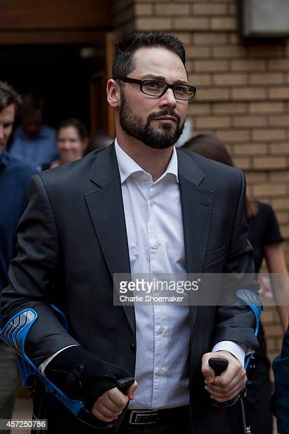 Oscar Pistorius's brother Carl Pistorius leave North Gauteng High Court following the third day of sentencing on October 15 2014 in Pretoria South...