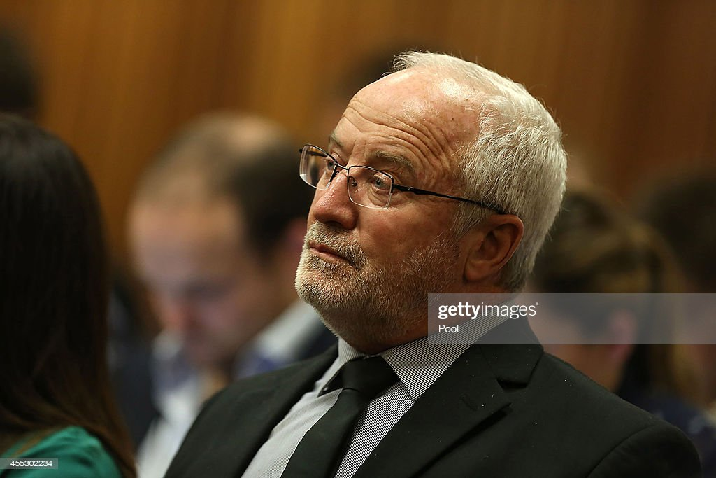 Oscar Pistorius's father Henke Pistorius sits during Oscar Pistorius' trial at the Pretoria High Court on September 12 in Pretoria South Africa South...