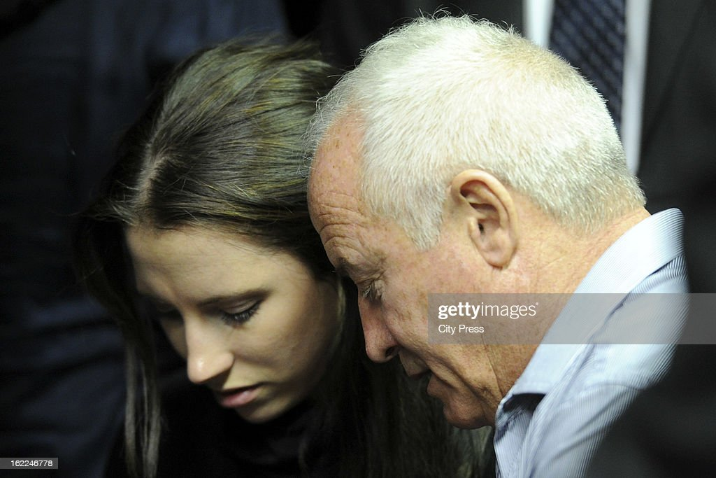 Oscar Pistorius's sister and father Aimee and Henk Pistorius during his bail hearing in the Pretoria Magistrate Court on February 21 2013 in Pretoria...