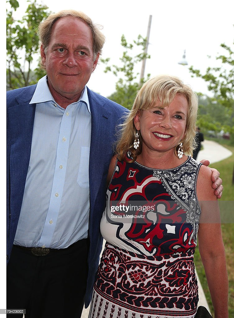 Oscar Plotkin and <a gi-track='captionPersonalityLinkClicked' href=/galleries/search?phrase=Sharon+Bush&family=editorial&specificpeople=217522 ng-click='$event.stopPropagation()'>Sharon Bush</a> attend the Parrish Art Museum 2013 Midsummer Party on July 13, 2013 in Southampton, United States.