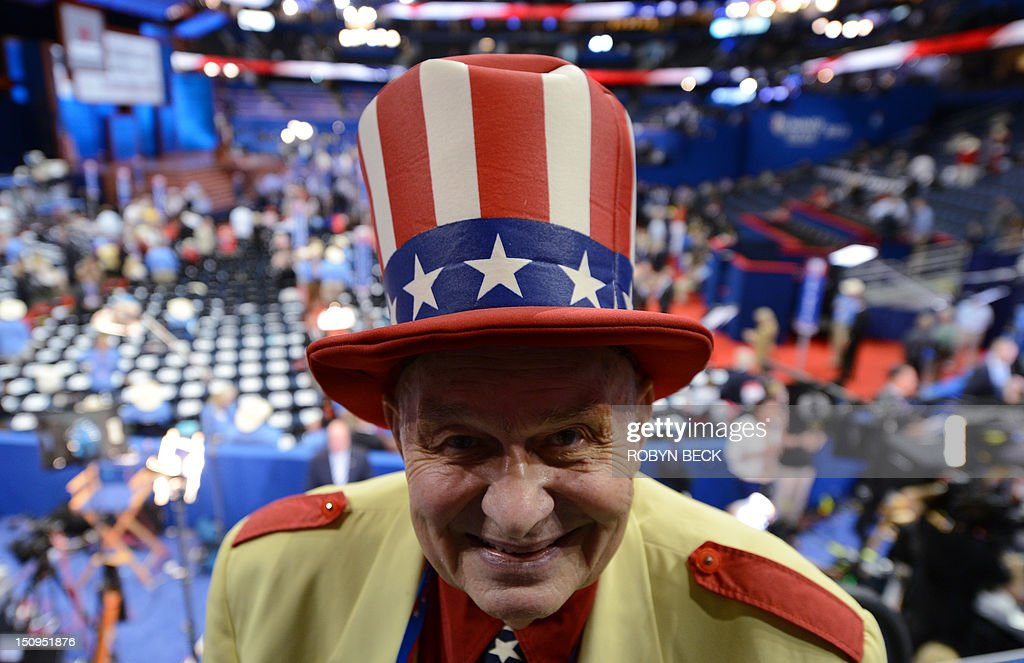 Oscar Poole from Georgia poses with a red white and blue top hat at the Tampa Bay Times Forum in Tampa Florida on August 29 2012 ahead of the day's...