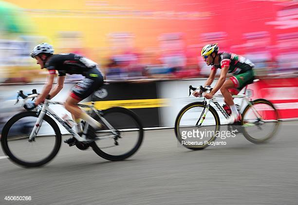 Oscar Pujol Munoz of Skydive Dubai Pro Cycling Team leads followed by Edgar Nohales Nieto of Team 7 Eleven Roadbike Phillipine during stage 9 of the...