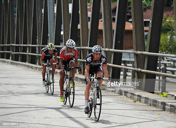 Oscar Pujol Munoz of Skydive Dubai Pro Cycling Team leads the small peleton followed by Hari Fitriyanto of Indonesia National Team and Edgar Nohales...