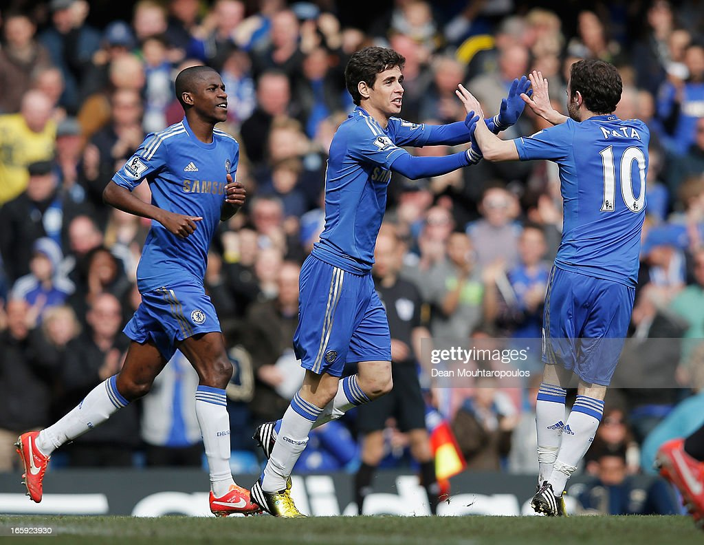 Oscar (C), Ramires (L) and <a gi-track='captionPersonalityLinkClicked' href=/galleries/search?phrase=Juan+Mata&family=editorial&specificpeople=4784696 ng-click='$event.stopPropagation()'>Juan Mata</a> of Chelsea celebrate the equalising goal, an own goal by Matthew Kilgallon of Sunderland during the Barclays Premier League match between Chelsea and Sunderland at Stamford Bridge on April 7, 2013 in London, England.