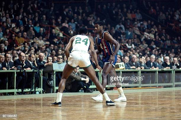 Oscar Robertson of the Cincinnati Royals moves the ball up court against Sam Jones of the Boston Celtics during a game played in 1967 at the Boston...