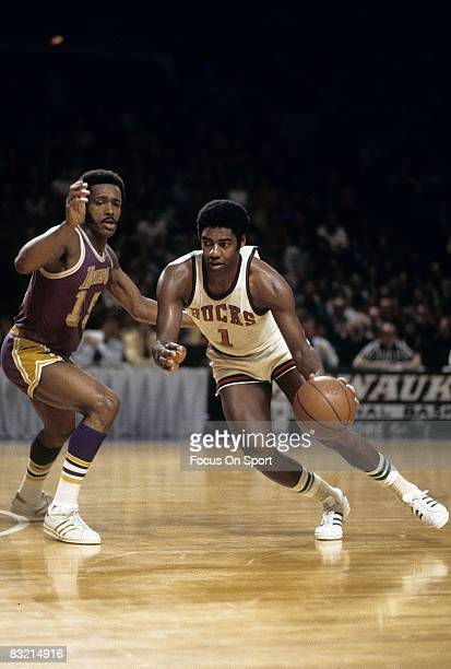 Oscar Robertson of the Milwaukee Bucks drives pass Jim Price of the Los Angeles Lakers during a circa 1973 NBA basketball game at the Milwaukee Arean...
