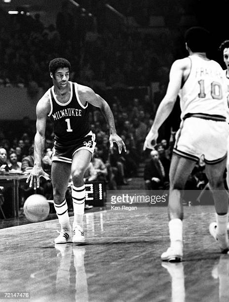 Oscar Robertson of the Milwaukee Bucks drives to the basket against Walt Frazier of the New York Knicks in 1974 at Madison Square Garden in New York...