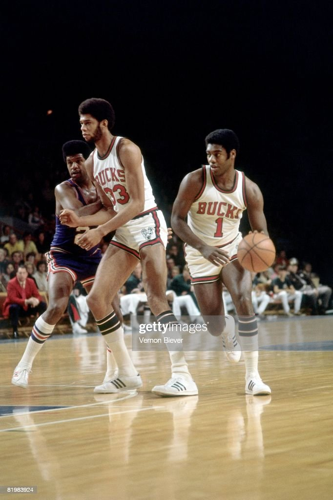 Oscar Robertson of the Milwaukee Bucks moves the ball up court during a game against the Buffalo Braves in the 1971 season at the MECCA Arena in...
