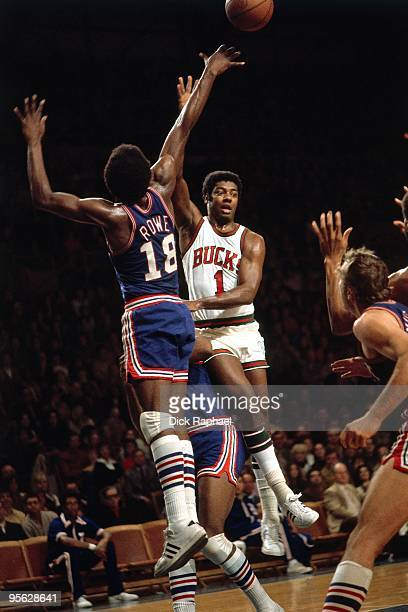 Oscar Robertson of the Milwaukee Bucks passes against Curtis Rowe of the Detroit Pistons during a game played in 1971 at Mecca Arena in Milwaukee...