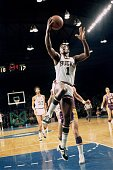 Oscar Robertson of the Milwaukee Bucks shoots a layup during a game against the Los Angeles Lakers in the 1970 season at the MECCA Arena in Milwaukee...
