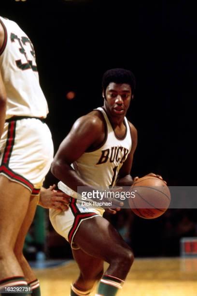 Oscar Robertson of the Milwaukee Bukcs dribbles the ball against the Boston Celtics circa 1971 at the Boston Garden in Boston Massachusetts NOTE TO...