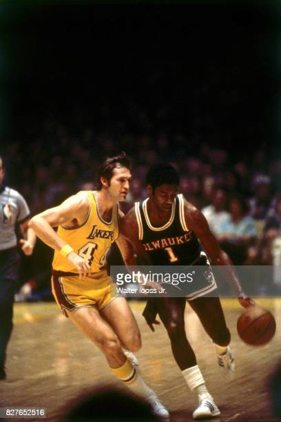 Oscar Robinson of the Milwaukee Bucks dribbles the ball up court while guarded by against Jerry West of the Los Angeles Lakers at The Forum in Los...
