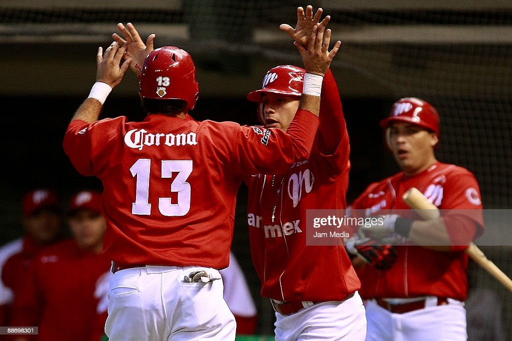 Oscar Robles and Eduardo Arredondo of Mexico's Diablos Rojos celebrate during the game against Broncos of Reynosa valid for the Mexican Baseball League 2009 at Foro Sol on June 25, 2009 in Mexico City, Mexico.