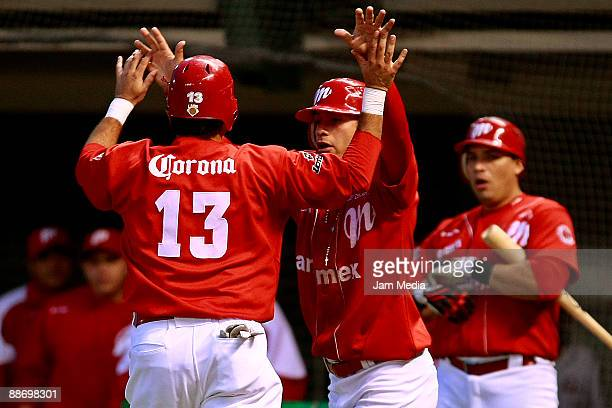 Oscar Robles and Eduardo Arredondo of Mexico's Diablos Rojos celebrate during the game against Broncos of Reynosa valid for the Mexican Baseball...