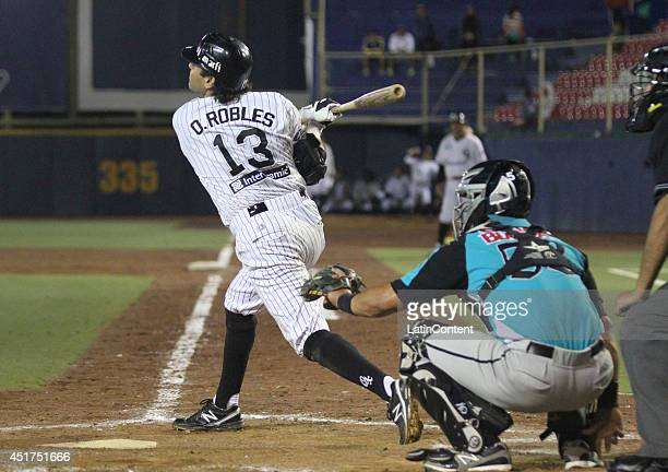 Oscar Robles bats the ball during a match between Saraperos de Saltillo and Guerreros de Oaxaca as part of the Mexican Baseball League 2014 at...