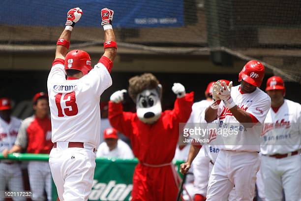 Oscar Robles of Diablos Rojos and team mates celebrate against Acereros de Monclova during their match at the end of the 2010 Liga Mexicana de...