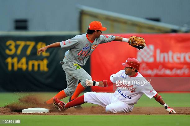 Oscar Robles of Diablos Rojos in action against Julian Laurean of Vaqueros Laguna during a match between Diablos Rojos and Vaqueros Laguna as part of...