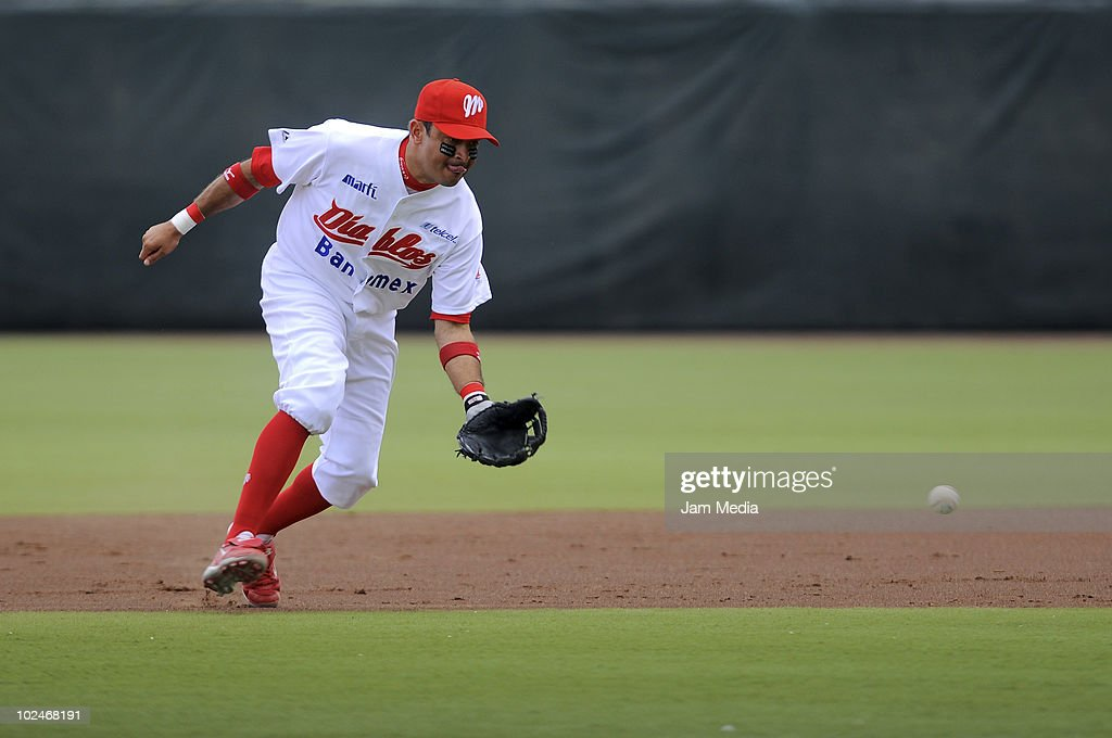 Oscar Robles of Diablos Rojos in action during a match against Dorados de Chihuahua as part of the 2010 Mexican Baseball League at Foro Sol Stadium...
