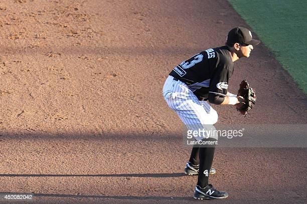 Oscar Robles of Guerreros looks on during a match between Delfines del Carmen and Guerreros de Oaxaca as part of the Mexican Baseball League 2014 at...