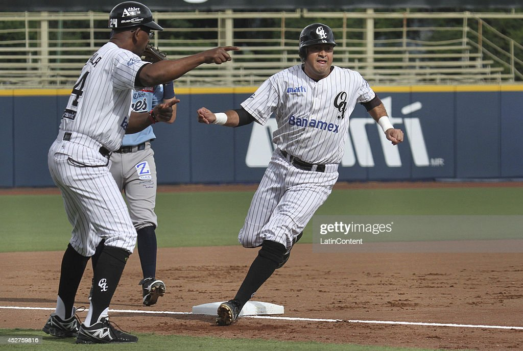 <a gi-track='captionPersonalityLinkClicked' href=/galleries/search?phrase=Oscar+Robles&family=editorial&specificpeople=240426 ng-click='$event.stopPropagation()'>Oscar Robles</a> of Guerreros runs to the third base during a match between Tigres de Quintana Roo and Guerreros de Oaxaca as part of the Mexican Baseball League 2014 at Eduardo Vasconcelos Stadium on July 26, 2014 in Oaxaca, Mexico.