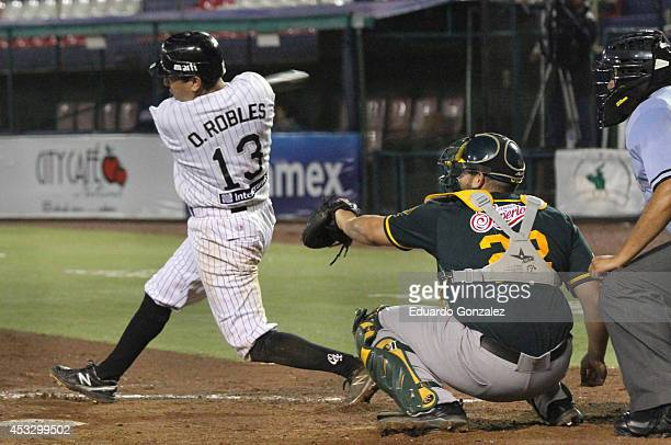 Oscar Robles of Guerreros swings the ball during a match between Olmecas de Tabasco and Guerreros de Oaxaca as part of the Mexican Baseball League...