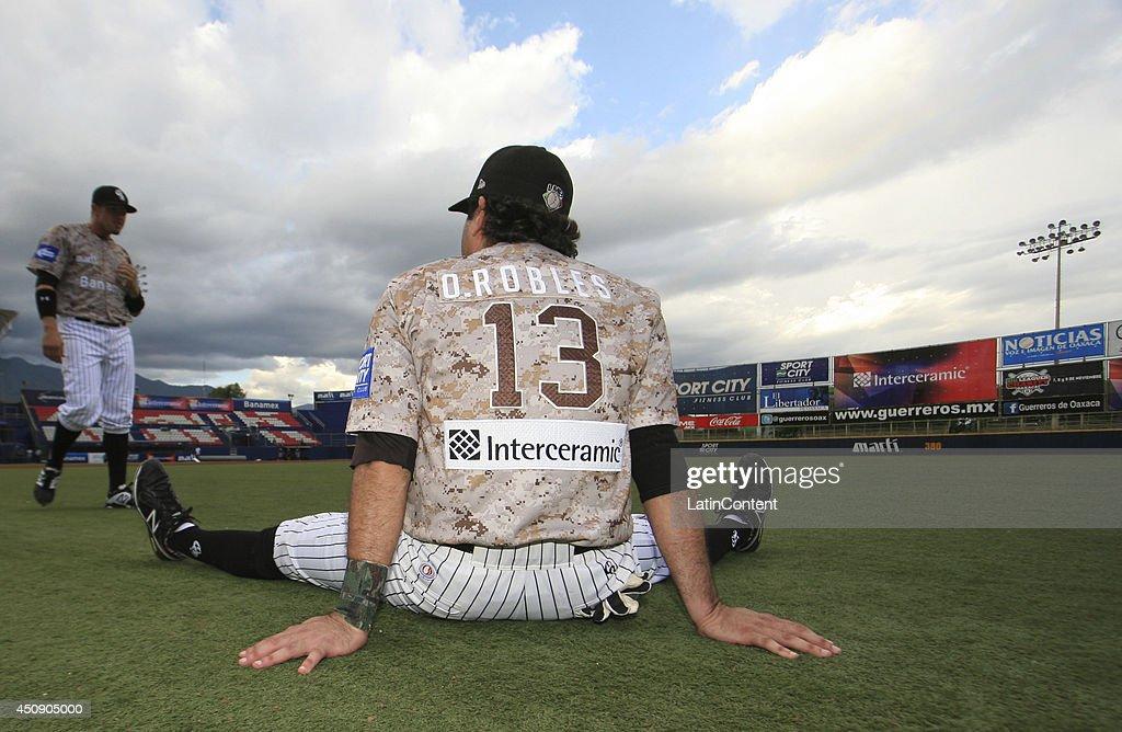 Oscar Robles of Guerreros warms up before a match between Toros de Tijuana and Guerreros de Oaxaca as part of the Mexican Baseball League 2014 at...