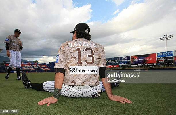 Oscar Robles of Guerreros warms up before a match between Toros de Tijuana and Guerreros de Oaxaca as part of the Mexican Baseball League 2014 at...