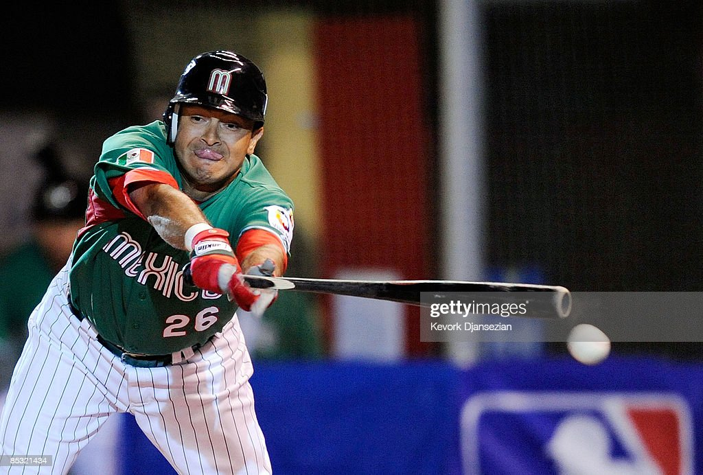 Oscar Robles #26 of Mexico breaks his bat during play against South Africa during the 2009 World Baseball Classic Pool B match on March 9, 2009 at the Estadio Foro Sol in Mexico City, Mexico.