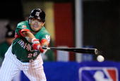 Oscar Robles of Mexico breaks his bat during play against South Africa during the 2009 World Baseball Classic Pool B match on March 9 2009 at the...
