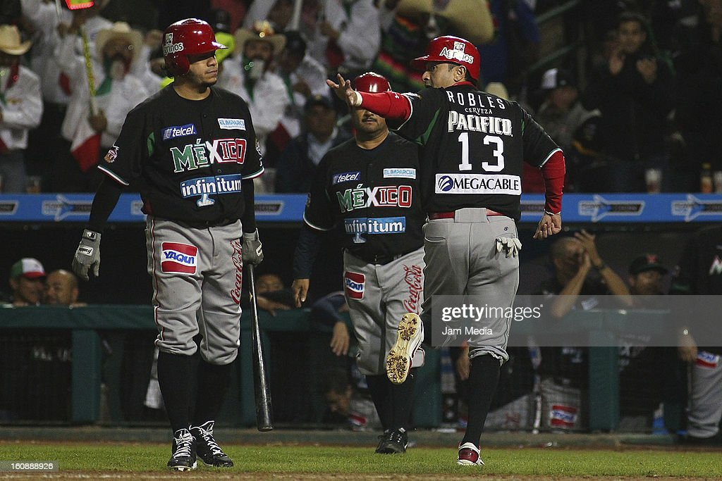 <a gi-track='captionPersonalityLinkClicked' href=/galleries/search?phrase=Oscar+Robles&family=editorial&specificpeople=240426 ng-click='$event.stopPropagation()'>Oscar Robles</a> of Mexico runs during a match between Mexico and Puerto Rico for the Caribbean Series 2013 on February 6, 2013 in Hermosillo, Mexico.