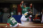 Oscar Robles of Mexico scores a run and Kyle Botha of South Africa looks for the ball during the World Baseball Classic 2009 on March 9 2009 in...