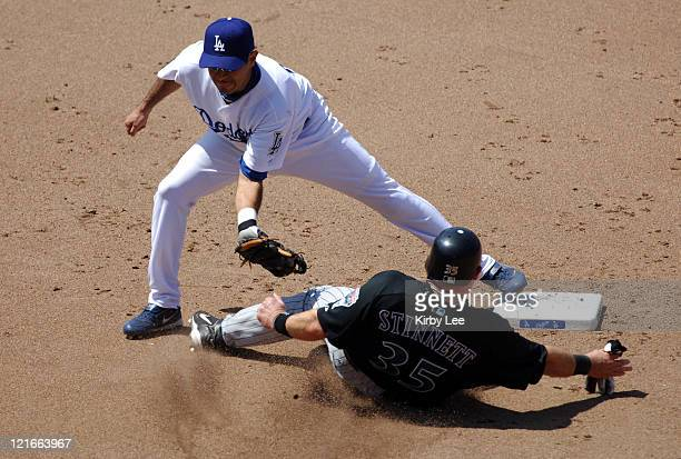 Oscar Robles of the Los Angeles Dodgers tags out Kelly Stinnett of the Arizona Diamondbacks at second base in the seventh inning of 75 loss at Dodger...