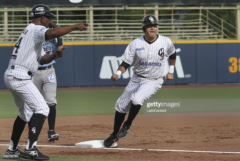 <a gi-track='captionPersonalityLinkClicked' href=/galleries/search?phrase=Oscar+Robles&family=editorial&specificpeople=240426 ng-click='$event.stopPropagation()'>Oscar Robles</a> runs to the third base during a match between Tigres de Quintana Roo and Guerreros de Oaxaca as part of the Mexican Baseball League 2014 at Eduardo Vasconcelos Stadium on July 26, 2014 in Oaxaca, Mexico.