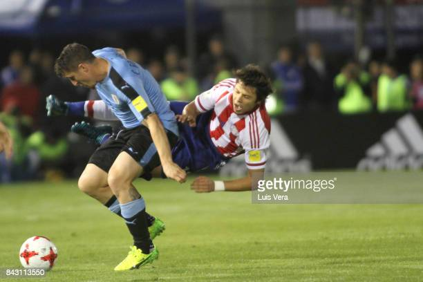 Oscar Romero of Paraguay and Cristian Rodriguez of Uruguay fight for the ball during a match between Paraguay and Uruguay as part of FIFA 2018 World...