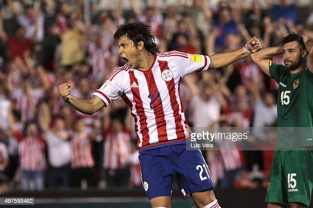 Oscar Romero of Paraguay celebrates after teammate Dario Lezcano scored the first goal of his team during a match between Paraguay and Bolivia as...