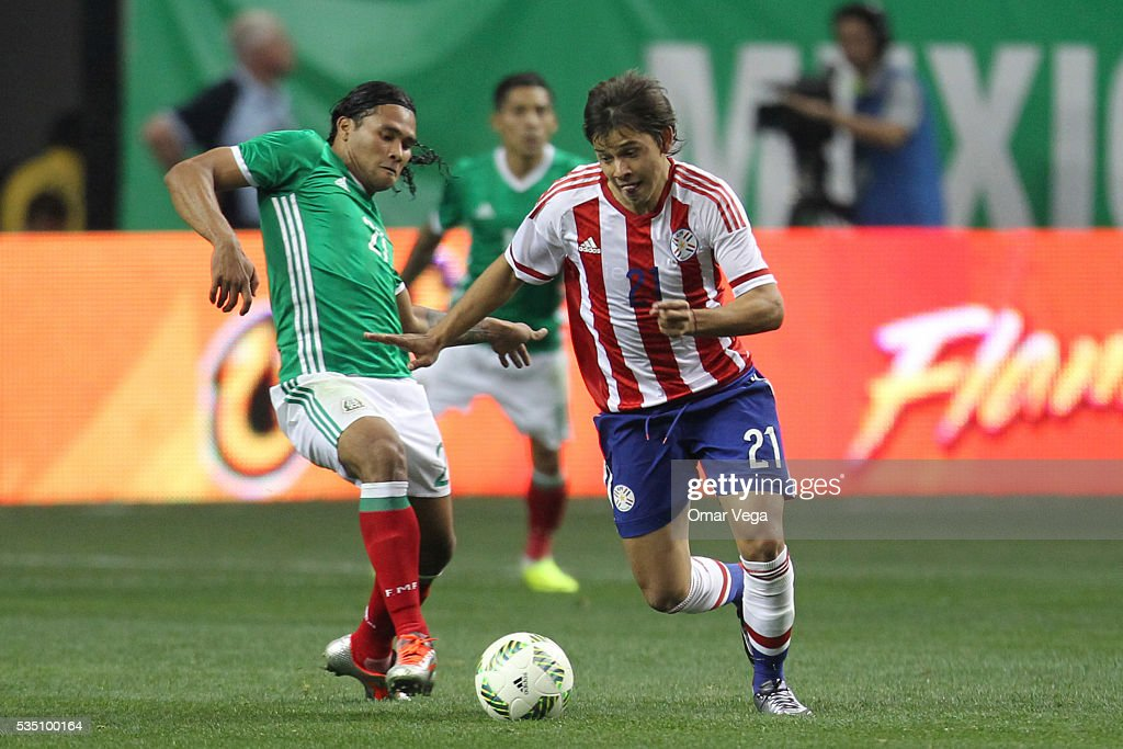 Oscar Romero of Paraguay drives the ball during the International Friendly between Mexico and Paraguay at Georgia Dome on May 28, 2016 in Atlanta, Georgia.