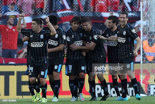 Oscar Romero of Racing Club celebrates with teammates after scoring the second goal of his team during a first leg match between Independiente and...
