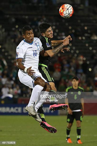 Oscar Salas of Honduras and Victor Guzman of Mexico vie for a head ball during 2015 CONCACAF Olympic Qualifying at Dick's Sporting Goods Park on...