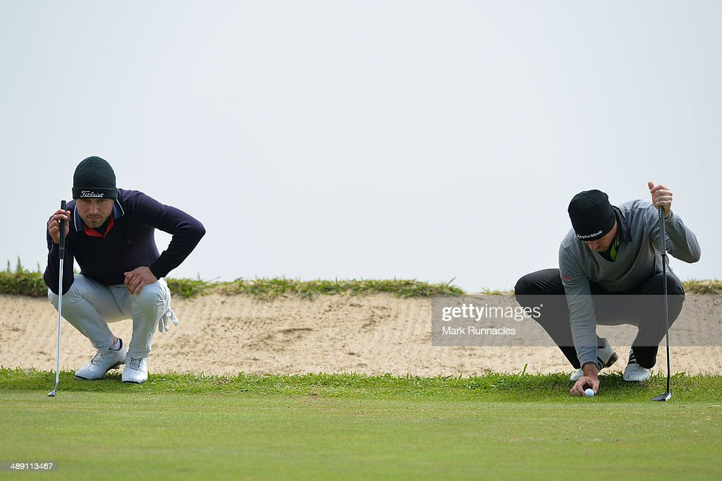 Oscar Stark of Sweden (L) and Julien Guerrier of France line up their putts on the 4th green during the Madeira Islands Open - Portugal - BPI at Club de Golf do Santo da Serra on May 10, 2014 in Funchal, Madeira, Port gal.