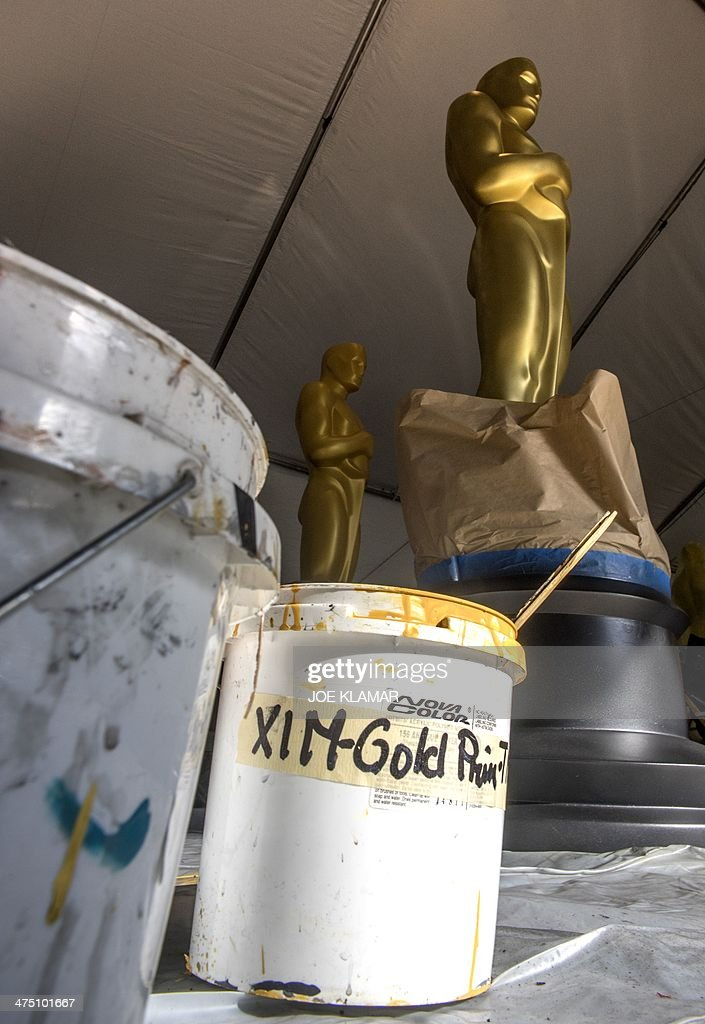 Oscar statues wait for to be formally displayed as preparations continue along Hollywood Boulevard outside the Dolby Theater on February 26 2014 in...