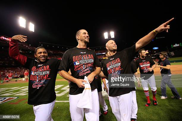 Oscar Taveras Adam Wainwright and Matt Holliday of the St Louis Cardinals celebrate with teammates after defeating the Los Angeles Dodgers in Game...